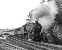 A southbound freight leans into the curve at Eamont Bridge on the southern outskirts of Penrith in September 1967 behind Stanier 8F 2-8-0 no 48551. <br><br>[Colin Miller&nbsp;/09/1967]