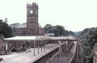 Ulverston station was built by the Furness Railway to replace the Ulverston and Lancaster Railway station and its own nearby terminus thereby providing a proper through station that could also act as a junction for the Lakeside branch. In 1981 when this picture was taken the station canopies were very much under threat but thankfully later saved. [See image 22161] for a modern day comparison. View west towards Barrow-in-Furness.<br><br>[Mark Bartlett&nbsp;28/06/1981]