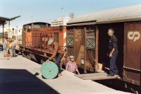 Algarve branch goods being unloaded at Portimao, Portugal on 22 September 1989. Loco is 1211. <br><br>[Bill Roberton&nbsp;22/09/1989]