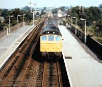 A class 25 with an inspection saloon runs south through Appleby station around 1983. The link to the former NER Eden Valley line runs off to the right in front of the signal box in the background.<br><br>[Colin Alexander&nbsp;//1983]