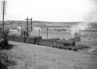 Ex-NB <I>Scott</I> class 4-4-0 no 62418 <I>The Pirate</I> about to run into Inverkeithing station in 1958 with a train for Edinburgh off the Dunfermline line. A second train, on the Fife Coast route, can be seen standing at signals on the approach to Inverkeithing East Junction in the background. The area in the middle distance is now an industrial estate.<br><br>[Robin Barbour Collection (Courtesy Bruce McCartney)&nbsp;//1958]