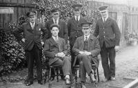 A posed photograph of the staff at Coalburn station, Lanarkshire, around 1931. The Station Master is seated on the right with Tom Steele, then station clerk, in the other chair. The photograph was taken some two years before Tom Steele was appointed Station Master at Crossmyloof.<br><br>[Ian Steele Collection&nbsp;//1931]