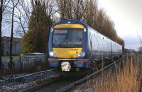 170 460 nears Blackgrange level crossing with a Glasgow Queen Street - Alloa service on 20 January.<br><br>[Bill Roberton&nbsp;20/01/2009]