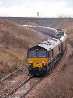 EWS 66197 passes Kilbagie on 20 January 2009 with a Hunterston-Longannet coal train on the direct route via Stirling and Alloa.<br><br>[Bill Roberton&nbsp;20/01/2009]