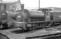 BR class Y9 0-4-0 ST no 68102, complete with wooden tender and dumb buffers, stands at St Margarets shed in January 1958. Introduced as the Holmes G class by the NBR in 1882 the last example was withdrawn by BR in 1962. Another long term resident of St Margarets, W Worsdell J72 0-6-0T no 69014, stands alongside.<br><br>[Robin Barbour Collection (Courtesy Bruce McCartney)&nbsp;03/01/1958]