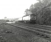 Brush Type 4 D1856 brings the up Royal Scot through the loops at Eamont Bridge in September 1967, passing the site of the former junction for the Keswick/Workington line.<br> <br><br>[Colin Miller&nbsp;25/09/1967]
