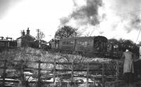 There is still some snow on the ground as 50731 pulls its autocoach into Woolfold station on its way from Bury Bolton Street to Holcombe Brook, the scene captured by Cam Camwell and his pals in February of 1952. This picture, looking towards Tottington and Holcombe Brook, shows the buffers of the elevated sidings in the goods yard behind the station building, all now swept away. <br><br>[W A Camwell Collection (Courtesy Mark Bartlett)&nbsp;03/02/1952]
