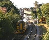 A Bridlington - Sheffield service, formed by 158817, runs into Driffield station on 1 October 2008, passing a stabled tamper almost hidden in the undergrowth.<br><br>[John Furnevel&nbsp;01/10/2008]