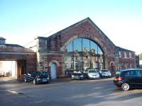 The original Furness Railway passenger terminus at Ulverston only lasted 20 years until 1874 when it was replaced by the current through station. It survived for many years as a railway goods depot, alongside its replacement, but has now been converted into a Mercedes showroom that retains many original railway features including the glazed frontage.<br><br>[Mark Bartlett&nbsp;17/01/2009]