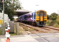 A Northern Trains 158 pulls away from Filey in September 2008 and is about to traverse the level crossing over the A1039 with a service for Scarborough.<br><br>[John Furnevel&nbsp;28/09/2008]