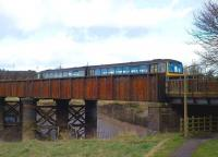 143619 crossing the bridge over the River Trym shortly after leaving Sea Mills station on 23 January with the 1234 Bristol Temple Meads - Avonmouth service. <br> <br><br>[Peter Todd&nbsp;23/01/2009]