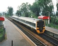 View south over Bridge of Allan station towards Stirling in June 1998, as ScotRail unit 158 724 arrives with a Dunblane service. <br><br>[David Panton&nbsp;/06/1998]
