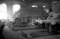 Twilight of steam at Dalry Road shed in January 1964. Residents include A4 Pacific 60006 <I>Sir Ralph Wedgwood</I>, stored here temporarily between transfer from Peterborough's New England shed in late 1963 and reinstatement at Ferryhill on 4 May 1964. Also present are Black 5 45477 and standard class 4 tank 80006. Dalry Road shed was officially closed on 3 October 1965.<br><br>[Robin Barbour Collection (Courtesy Bruce McCartney)&nbsp;03/01/1964]