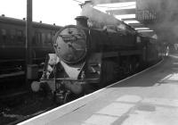 Standard class 5 4-6-0 no 73064 waits to depart from Gourock with a Glasgow train in July 1963.<br><br>[Colin Miller&nbsp;12/07/1963]