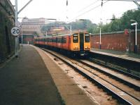 314 209 seen at Bridgeton in September 1998 on a service to Coatbridge Central, as a bus passes the station entrance on London Road heading for the city centre.  <br><br>[David Panton&nbsp;11/09/1998]