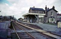 The deserted platforms of the closed station at Histon, on the St Ives, Cambridgeshire, branch in 1981. The 1847 station building is seen here occupied by a flooring company. [Editors note: The branch closed to passengers in 1970 with closure of the final freight-only section of the line in 1992. It is planned to convert the former branch into the worlds longest guided busway with effect from the summer of 2009 - see news item.] <br><br>[Ian Dinmore&nbsp;//1981]