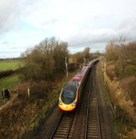 A down Pendolino is seen from a footbridge on the WCML just north of Preston on 24 January 2009. The train is about to pass under the A6 on its journey to Lancaster.<br> <br><br>[John McIntyre&nbsp;24/01/2009]