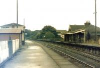 The old Stewarton station, photographed looking along the northbound platform towards Dunlop  in June 1974. Single line working had been introduced by that time and lifting of the former southbound line was in progress with some removed sections of track stored on the redundant platform.<br> <br><br>[Colin Miller&nbsp;19/06/1974]