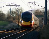 A northbound Pendolino approaches the footbridge at Woodacre, Lancs, on 24 January 2009.<br><br>[John McIntyre&nbsp;24/01/2009]