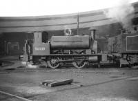 Drummond 0-4-0ST no 56038, minus wooden tender, comes off the turntable at Inverness in March 1959. The semi-circular open roundhouse closed in 1962 and was demolished the following year. <br><br>[Robin Barbour Collection (Courtesy Bruce McCartney)&nbsp;25/03/1959]