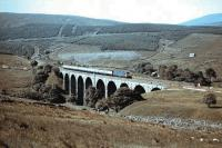A class 31 on a northbound passenger train shortly after leaving Blea Moor Tunnel, photographed crossing Dent Head Viaduct around 1983. <br> <br><br>[Colin Alexander&nbsp;//1983]
