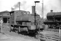 Aspinall L&YR class 21 0-4-0ST  no 51206, fitted with blast - deflecting device [see image 24841], standing outside Bank Hall shed, Liverpool in 1958. The diminutive <I>Pug</I>, built at Horwich Works in 1891, spent most of its 71 years shunting in Liverpool Docks, before finally returning to Horwich for disposal in 1962. Bank Hall shed itself closed in 1966 and the site is now occupied by Kirkdale EMU depot.<br> <br><br>[Robin Barbour Collection (Courtesy Bruce McCartney)&nbsp;26/09/1958]