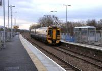 Standing on the recently commissioned platform at Uphall station on 29 January looking towards Edinburgh, as 158 735 pulls into the westbound platform with a Bathgate service.<br><br>[David Panton&nbsp;29/01/2009]