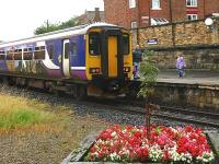High summer and typical tourist weather greets people to this popular resort as a class 156 stands at Whitby in August 2008<br><br>[Ian Dinmore&nbsp;02/08/2008]