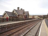 Superbly restored, and now available as holiday accommodation, the main station building at Dent is fenced off from the platform but still looks the part. To the rear, from its elevated position, is a panoramic view of Dentdale. This picture looks north towards Garsdale and shows the <I>Coal Road</I> overbridge, still displaying its white painted signal sighting patch, that has featured in so many photographs over the years.  <br><br>[Mark Bartlett 31/01/2009]