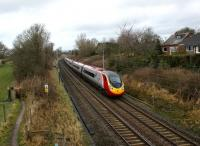 A southbound Pendolino approaches the footbridge alongside the site of Barton & Broughton station, Lancs, on 24 January 2009.<br><br>[John McIntyre&nbsp;24/01/2009]