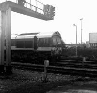 Hanson class 59 locomotive no 59104 <I>Village of Great Elm</I> arrives alongside Westbury station on 28 January at the head of an eastbound stone train originating from one of the nearby Mendip quarries. <br> <br><br>[Peter Todd&nbsp;28/01/2009]