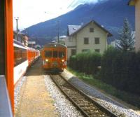 Scene on the western outskirts of Brig in August 1998 as a Zermatt-Davos Glacier Express waits in the loop for a Brig bound local train to pass.<br> <br><br>[Fraser Cochrane&nbsp;/08/1998]