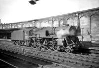 One of three Crosti boilered 9F 2-10-0s allocated to Kingmoor shed for a period, no 92024, stands at the south end of Carlisle station in July 1959. The locomotive was converted to conventional operation in 1960. <br> <br><br>[Robin Barbour Collection (Courtesy Bruce McCartney)&nbsp;04/07/1959]