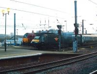 Grand Central HST power car 43123 passes EWS 67002 <I>Special Delivery</I> at the west end of Newcastle Central on 31 January 2009, (destination unknown).  <br><br>[Colin Alexander&nbsp;31/01/2009]
