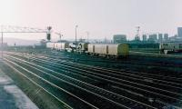 View west towards King Edward Bridge East Junction from Gateshead MPD on a summer evening in 1982 with the Gateshead breakdown crane standing on the <I>ash heaps</I> at the west end of the depot. The line to the right at the junction runs onto the bridge, part of which can be seen between the breakdown train and the class 31. The line to the left joins the ECML from Newcastle Central shortly after it leaves the bridge. <br> <br><br>[Colin Alexander&nbsp;//1982]