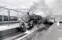 BR Standard class 5 no 73059 of Polmadie shed is about to take a train out of Gourock in the summer of 1966. The locomotive's final trip was undertaken in August the following year, to Campbells of Airdrie, a mere 13 years to the month after emerging new from Derby works. <br><br>[Colin Miller&nbsp;//1966]