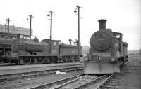 A pair of Holmes J36 0-6-0s, nos 65282 and 65267 on shed at Bathgate in April 1965. At least 4 of these locomotives, introduced by the North British Railway in 1898, were still in service in 1967, making them one of the last operational pre-grouping designs on BR.   <br> <br><br>[Robin Barbour Collection (Courtesy Bruce McCartney)&nbsp;16/04/1965]