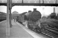 Parkhead V3 no 67662 is about to take a train out of Helensburgh Central and head for home in the late 1950s. In the right background stands the cramped 2-road Helensburgh shed (65H), officially closed in November 1970.   <br> <br><br>[Robin Barbour Collection (Courtesy Bruce McCartney)&nbsp;//]