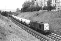 20121 has just passed the site of Gorgie East on the Edinburgh <I>sub</I> in May 1981 and is running south parallel with Hermand Terrace as a bus heads west along Slateford Road in the background.<br><br>[Peter Todd&nbsp;20/05/1981]