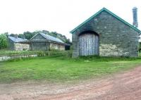 The station site at Whittingam in Northumberland, seen looking south east in August 2007. The site includes the old station, a sizeable yard, goods shed, station master's house and 5 terraced cottages.<br><br>[John Furnevel&nbsp;08/08/2007]