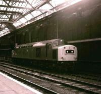 40145 stands below the cross-station walkway alongside the south wall at Edinburgh Waverley station on 13 April 1982. The locomotive is standing on a spot now occupied by platform 10.  <br> <br> <br> <br> <br> <br> <br> <br> <br> <br> <br> <br> <br> <br> <br> <br> <br> <br> <br> <br> <br> <br> <br><br>[Peter Todd&nbsp;13/04/1982]