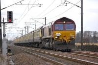 Pathfinder <I>Forth McFreighter</I> railtour approaching St Germains level crossing on 8 February with EWS 66201 leading on the leg to North Berwick.<br><br>[Bill Roberton&nbsp;08/02/2009]