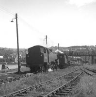 The sidings at Gourock in July 1963, with locomotives awaiting the call to take over trains back to Glasgow Central. Meantime one of the crews takes a break and a well earned cuppa alongside the River Clyde.<br><br>[Colin Miller&nbsp;12/07/1963]