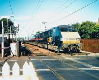 Teatime at Kingsknowe station on a warm summer's afternoon in July 1999 as a GNER Kings Cross - Glasgow Central service runs west over the level crossing.<br><br>[David Panton&nbsp;/07/1999]