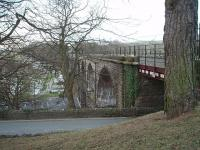 <I>Scene of a very expensive argument</I>. The bridge at Ingleton should have provided a through link from Yorkshire to Scotland. However, because it formed an end on junction between the Midland Railway and the LNWR, who were in dispute in the 1860's, that never transpired and the animosity between the two companies meant that through passengers arriving at one station would have to make their own way through the gorge to the station on the other side. In due course the Midland constructed the Settle and Carlisle Railway to avoid reliance on the LNWR instead. This view looks north from the site of the North Western station, now covered by a community centre and its car park although the viaduct, which last carried trains in 1966, is still in excellent condition.<br><br>[Mark Bartlett&nbsp;31/01/2009]