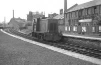 An early NBL 0-4-0 diesel hydraulic no D2705 has just turned off the ECML at Abbeyhill Junction in July 1963 and is seen running north through Abbeyhill station. One of a class first introduced in 1953, the locomotive was originally numbered 11705 by BR.<br><br>[Colin Miller&nbsp;18/07/1963]