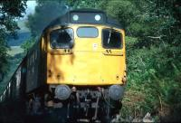 A Glasgow bound class 27 with a West Highland Line service near Faslane in August 1980.<br> <br><br>[Johnny Trippick&nbsp;/08/1980]