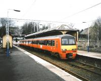 320 314 stands at Milngavie in March 1993 with a Springburn service, then the usual destination. Platform 2 track shows light usage.<br><br>[David Panton&nbsp;30/03/1993]