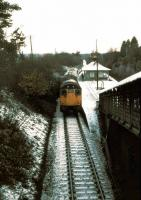 A Glasgow-bound West Highland Line service pulls into Helensburgh Upper station on a cold winter's day in 1979.<br><br>[Johnny Trippick&nbsp;//]