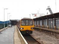 Having connected with the Isle of Man Ferry, 144004 waits to return to Leeds with the once a day service on the Heysham Port branch. The ship alongside the station is the brand new ferry <I>Clipper Panorama</I>, that was introduced on the Heysham to Belfast crossing around this time.<br><br>[Mark Bartlett&nbsp;14/02/2009]